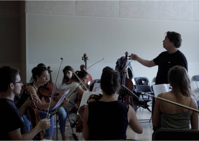 Professor Ostrovsky working with one of the two AIMS orchestras